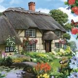 schönes Bauernhaus mit blumigen Garten